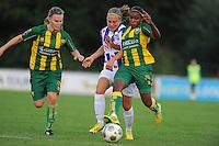 VOETBAL: HEERENVEEN: 02-09-2014, Sportpark Skoatterwâld, Damesvoetbal SC Heerenveen - ADO Den Haag, uitslag 0-3, Lianne de Vries (#22) in de tang, ©foto Martin de Jong