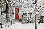 A red door in a white winter wonderland.