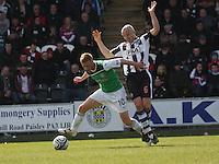 Eoin Doyle beats Jim Goodwin in the St Mirren v Hibernian Clydesdale Bank Scottish Premier League match played at St Mirren Park, Paisley on 29.4.12.