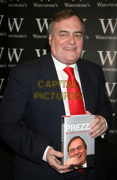 "JOHN PRESCOTT .attends his first book signing for his autobiography ""Prezza, My Story Pulling No Punches"" at Waterstones, Leadenhall Market, London, England, 30th May 2008..half length red tie Labour MP holding book.CAP/DS.©Dudley Smith/Capital Pictures"