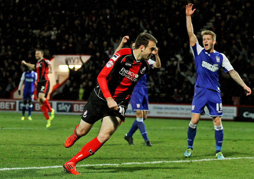 Bournemouth's Brett Pitman celebrates scoring the equalizing goal.<br /> Photo by James Marsh/CameraSport<br /> <br /> Football - The Football League Sky Bet Championship - AFC Bournemouth v Ipswich Town - Sunday 29th December 2013 - Goldsands Stadium - Bournemouth<br /> <br /> &copy; CameraSport - 43 Linden Ave. Countesthorpe. Leicester. England. LE8 5PG - Tel: +44 (0) 116 277 4147 - admin@camerasport.com - www.camerasport.com