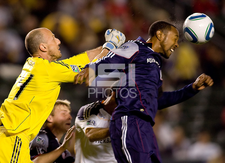 New England goalkeeper Preston Burpo and teammate defender Cory Gibbs work together to clear the ball from the box. The LA Galaxy defeated the New England Revolution 1-0 at Home Depot Center stadium in Carson, California on Saturday evening March 27, 2010.  .