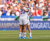 LYON,  - JULY 7: Allie Long #20 celebrates with Megan Rapinoe #15 during a game between Netherlands and USWNT at Stade de Lyon on July 7, 2019 in Lyon, France.