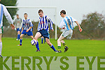 John Foley Ballyhar tackles Castlemaine's Thady O'Sullivan in Ballyhar on Saturday