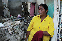 Woman who chooses not to be identified by name had moved to New Jersey and only recently returned to Tapachula in order to build her house which was destroyed by the floods caused by huricane Stan.  Miguel de la Madrid neighbourhood, Tapachula, Chiapas.