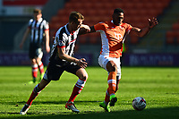 Blackpool's Jamille Matt competes with Grimsby Town's Danny Collins<br /> <br /> Photographer Richard Martin-Roberts/CameraSport<br /> <br /> The EFL Sky Bet League Two - Blackpool v Grimsby Town - Saturday 8th April 2017 - Bloomfield Road - Blackpool<br /> <br /> World Copyright &copy; 2017 CameraSport. All rights reserved. 43 Linden Ave. Countesthorpe. Leicester. England. LE8 5PG - Tel: +44 (0) 116 277 4147 - admin@camerasport.com - www.camerasport.com