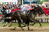 BALTIMORE, MD - MAY 20: Cloud Computing #2 (red cap), ridden by Javier Castellano, outduels Classic Empire #5, ridden Julien Leparoux, to win the Preakness Stakes on Preakness Stakes Day at Pimlico Race Course on May 20, 2017 in Baltimore, Maryland (Photo by Sue Kawczynski/Eclipse Sportswire/Getty Images)