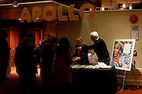New York, United States. 23th March 2014 - People buy DVDs during a special concert to commemorate the life and legacy of Celia Cruz at the Apollo theater in Harlem, New York. Photo by Eduardo Munoz Alvarez/VIEW