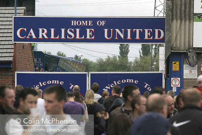 Fans gathering for a pre-season friendly between Carlisle United and Newcastle United at Cumbrian's Brunton Park ground. The match ended one goal each with Newcastle equalising Livesey's opener through Nolberto Solano in the last minute. During the 2007-08 season Carlisle played in League One, English football's third tier, while Newcastle were a top Premiership team.