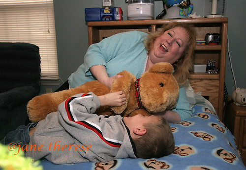 Lisa Salem of Telford, Pa., plays with her son Joseph 8, twin to Sophia, in his bedroom on a cold Thursday March 2, 2006, whom Joseph shares with twin brothers Sam and Jake 12. The Salem children, 3 sets of twins, are from Russia. Sophia and twin Joseph were adopted at 11 months of age by Hythem and his wife Lisa. The other twins, Selene and Julianne 13 along with Sam and Jake, were adopted just 20 months ago. All children are thriving in school, socially and physically. photo by jane therese