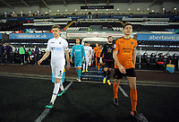 Pictured: (L-R) Team captains Keston Davies of Swansea City and Conor Levingston of Wolverhampton Wanderers exit the tunnel Monday 13 March 2017<br /> Re: Premier League 2, Swansea City U23 v Wolverhampton Wanderers FC at the Liberty Stadium, Swansea, UK