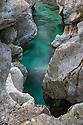 Soča river flowing through a narrow limestone gorge. Triglav National Park, Julian Alps, Slovenia, July.