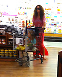 June 20th 2012 ..Brooke Burke shopping at Ralphs supermarket in Malibu California with her daughter sitting in the shopping cart. Brooke's hair was huge & curly almost looked like an afro .So she was hiding from the cameras...AbilityFilms@yahoo.com.805 427 3519.www.AbilityFilms.com.