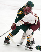 Daria O'Neill (UVM - 77), Caitrin Lonergan (BC - 11) -  The Boston College Eagles defeated the University of Vermont Catamounts 4-3 in double overtime in their Hockey East semi-final on Saturday, March 4, 2017, at Walter Brown Arena in Boston, Massachusetts.