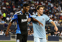 Khari Stephenson (black) San Jose Earthquakes  forward jostling for position with Matt Besler Sporting KC  defender... Sporting KC defeated San Jose Earthquakes 1-0 at LIVESTRONG Sporting Park, Kansas City, Kansas.