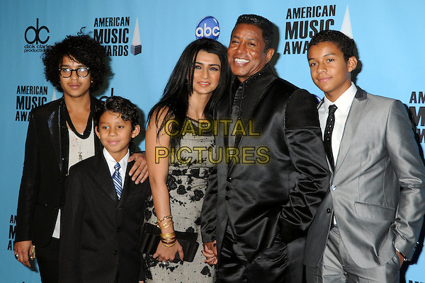 HALIMA RASHID, JERMAINE JACKSON & CHILDREN.At the 2009 American Music Awards - Press Room held at the Nokia Theatre L.A. Live, Los Angeles, California, USA, .22nd November 2009..AMA AMAs half length family kids married couple husband wife grey gray black dress suit tie holding hands son sons gold bracelets .CAP/ADM/BP.©Byron Purvis/AdMedia/Capital Pictures.