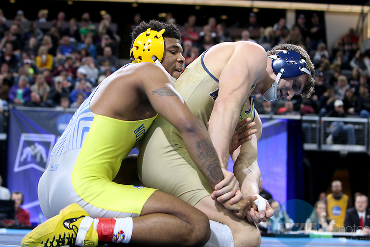 12 MARCH 2016:  Joey Davis from Notre Dame (OH) controls Travis Mckillop from Pitt.-Johnstown in their 184 pound weight class at the 2016 NCAA Men's Division II Wrestling Championship at the Denny Sanford Premier Center in Sioux Falls, S.D. Photo by Dave Eggen/NCAA Photos