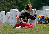 Kristin Kenney, from Edison, N.J., visits the grave of her boyfriend, Dennis Flanagan, an Army sergeant killed in January in Iraq, at Arlington National Cemetery, May 25, 2006.