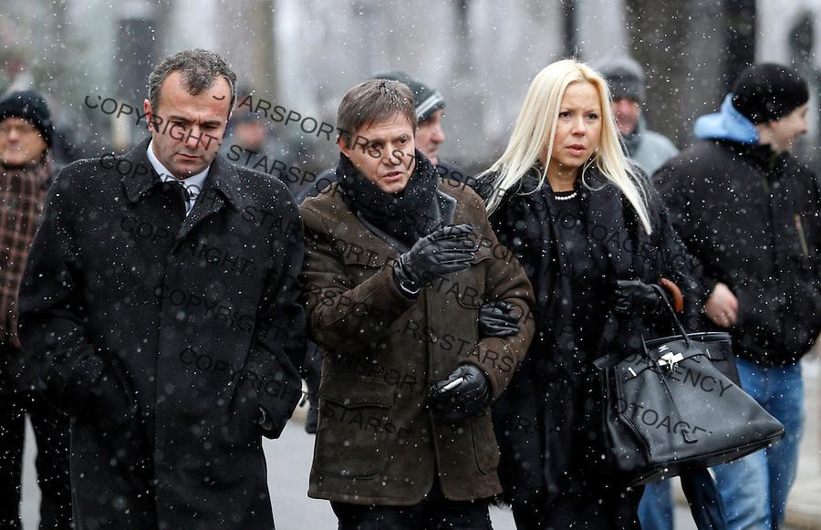 Dejan Savicevic, Dragan Stojkovic Piksi and Snezana Stojkovic at  Miljan Miljanic funeral in Belgrade, Serbia, Tuesday, January 17, 2011.  (photo: Pedja Milosavljevic / thepedja@gmail.com / +381641260959)