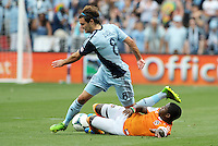 Graham Zusi (8) midfield Sporting KC goes past Oscar Boniek Garcia (27) midfield Houston Dynamo ..Sporting Kansas City and Houston Dynamo played to a 1-1 tie at Sporting Park, Kansas City, Kansas.