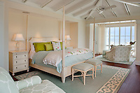 The Master Bedroom is light, airy and colorful