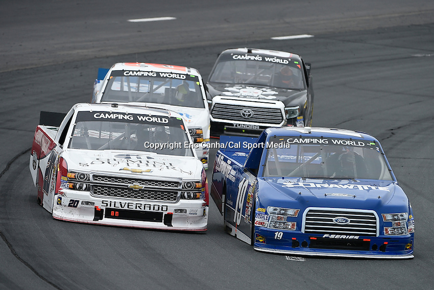 September 19, 2014 - Loudon, New Hampshire, U.S. -  NASCAR Camping World Truck Series drivers Gray Gaulding (20) and Tyler Reddick (19) battle during the NASCAR Camping World Truck Series UNOH 175 race held at the New Hampshire Motor Speedway in Loudon, New Hampshire.   Eric Canha/CSM