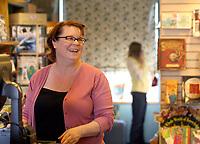 Arkansas Democrat-Gazette/JASON IVESTER 12-19-07<br />Lisa Sharp, owner, talks with customer Kristen Knight Wednesday inside Nightbird Books in Fayetteville.
