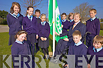 GOING GREEN: The Green Committee of Ardfert national school raising their third Green Flag with MEP Brian Crowley at the school on Friday morning, front l-r: Abigail O'Mahony, Shane Lowth, Oliver Frank. Back l-r: Emma Harrington, Norma Horan, Eric Leane, Victoria Murphy, Kevin Ashe, Michael Davis, Eoghan McElligott.