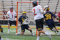 College Park, MD - April 1, 2017: Michigan Wolverines Tommy Heidt (30) tries to make a save during game between Michigan and Maryland at  Capital One Field at Maryland Stadium in College Park, MD.  (Photo by Elliott Brown/Media Images International)