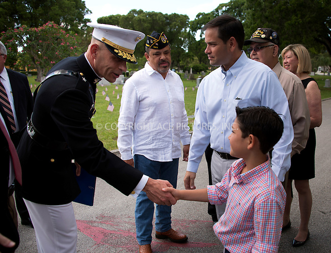 WWW.ACEPIXS.COM<br /> <br /> May 30 2016, Miami<br /> <br /> Former presidential candidates and U.S. Senator Marco Rubio and his son Anthong attend 'Remembering Our Heroes' at a Memorial Day Ceremony on May 30, 2016 in Miami, Florida.<br /> <br /> By Line: Solar/ACE Pictures<br /> <br /> <br /> ACE Pictures, Inc.<br /> tel: 646 769 0430<br /> Email: info@acepixs.com<br /> www.acepixs.com