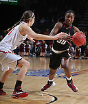 SIOUX FALLS, SD - MARCH 9: Akilah Sims #30 of IUPUI drives against Lisa Loeffler #44 of USD in the first half of their semi-final round Summit League Championship Tournament game Monday afternoon at the Denny Sanford Premier Center in Sioux Falls, SD. (Photo by Dick Carlson/Inertia)