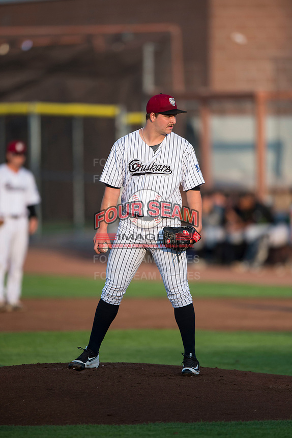 Idaho Falls Chukars starting pitcher Jon Heasley (51) looks in for the sign during a Pioneer League game against the Great Falls Voyagers at Melaleuca Field on August 18, 2018 in Idaho Falls, Idaho. The Idaho Falls Chukars defeated the Great Falls Voyagers by a score of 6-5. (Zachary Lucy/Four Seam Images)