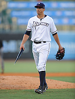 NWA Democrat-Gazette/ANDY SHUPE<br /> Northwest Arkansas Naturals starter Kyle Zimmer returns to the dugout Wednesday, Aug. 12, 2015, carrying a broken bat against San Antonio during the third inning at Arvest Ballpark in Springdale.