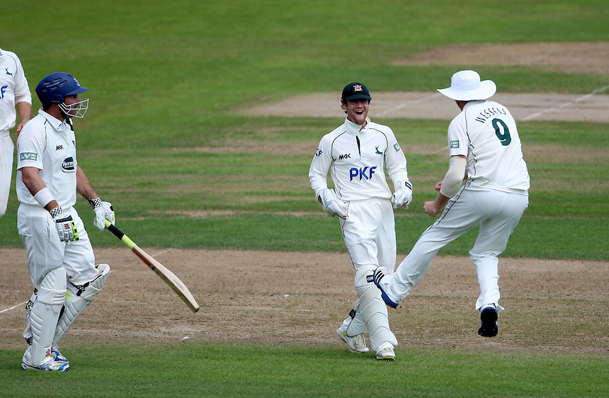 Nottinghamshire's Riki Wessels celebrates running out Sussex's Michael Yardy  with Chris Read..County Cricket - Liverpool Victoria County Championship - Division One - Nottinghamshire v Sussex - Day 1 Friday 27th July 2012 - Trent Bridge - Nottingham..