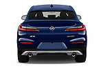 Straight rear view of a 2020 BMW X4 xDrive30i 5 Door SUV stock images
