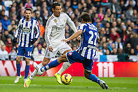 Real Madrid´s Cristiano Ronaldo and Deportivo de la Coruna's Celso Borges during 2014-15 La Liga match between Real Madrid and Deportivo de la Coruna at Santiago Bernabeu stadium in Madrid, Spain. February 14, 2015. (ALTERPHOTOS/Luis Fernandez) /NORTEphoto.com