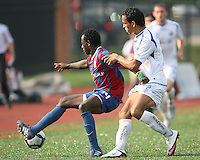 Mathew Mbuta #14 of Crystal Palace Baltimore moves the ball away from Hicham Aaboubou #2 of the Montreal Impact during an NASL match at Paul Angelo Russo Stadium in Towson, Maryland on August 21 2010. Montreal won 5-0.