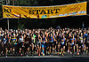 Northport's annual Cow Harbor 10K run gets underway as competitors break from the starting line on Saturday, Sept. 17, 2016.