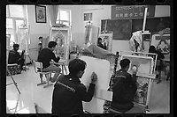 Yushu City, Yushu Tibetan Autonomous Prefecture, Qinghai Province, China - Tibetan youths learn how to draw Thangka, a Tibetan Buddhist painting on cotton, silk appliqué, usually depicting a Buddhist deity, scene, or mandala, August 2019.
