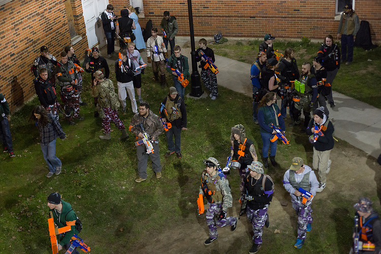 Players of Humans vs. Zombies get ready for the night's mission on West Green on March 23, 2017.