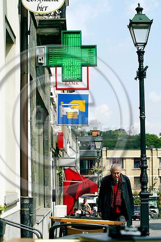 BRUSSELS - BELGIUM - 22 MAY 2004--Bank og apotek side om side i Tervuren uden for Bruxelles. -- PHOTO: ERIK LUNTANG / EUP-IMAGES