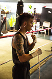 USA, Oahu, Hawaii, an up and coming boxer prepares his hands for a sparring match in a gym in Honolulu