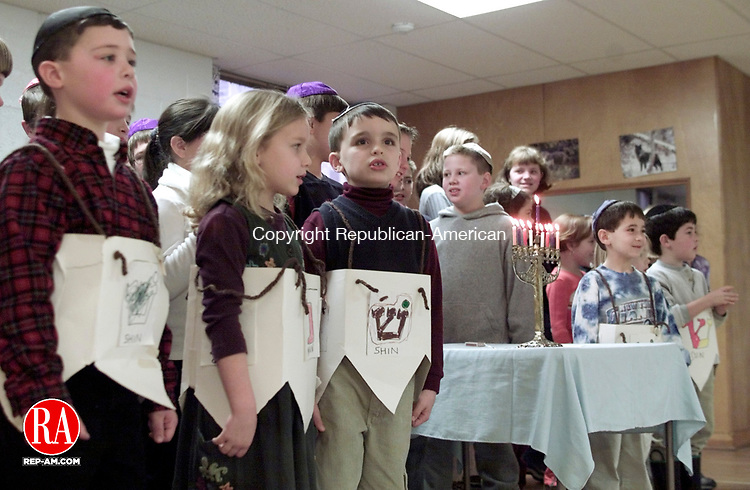TORRINGTON CT 12/17/00 1217BS02.TIF--Children sing a dreidel song at Beth El Synagogue Sunday during a Hanukkah party hosted by the Beth El Religious School in Torrington. The children enjoyed latkes after their performance.  BOBBY SANCHEZ PHOTOS