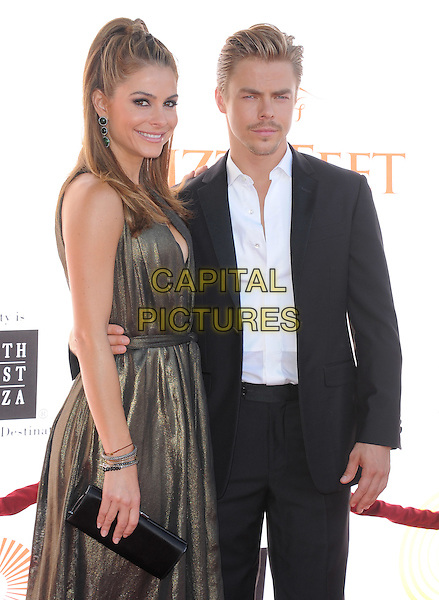 Maria Menounos and Derek Hough .attends the Dizzy Feet Foundation's Celebration of Dance Gala held at The Dorothy Chandler Pavilion at The Music Center in Los Angeles, California, USA,  July 28th 2012..half length brown dress bronze gold lame clutch bag  black suit white shirt                                        .CAP/RKE/DVS.©DVS/RockinExposures/Capital Pictures.