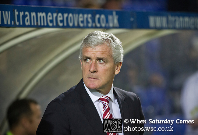 Tranmere Rovers 0 Stoke City 2, 25/09/2013. Prenton Park, Captial One Cup Third Round. Visiting manager Mark Hughes glances around from the dugout at Prenton Park before Tranmere Rovers host Stoke City in a Capital One Cup third round match. The Capital One cup was formerly known as the League Cup and was competed for by all 92 English Premier League and Football League clubs. Visitors Stoke City won the match 2-0, watched by a crowd of 5,559 spectators. Photo by Colin McPherson.