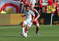 23 June 2011: New England Revolution forward Diego Fagundez #14 and Toronto FC defender Richard Eckersley #27 in action during an MLS game between the New England Revolution and the Toronto FC at BMO Field in Toronto.