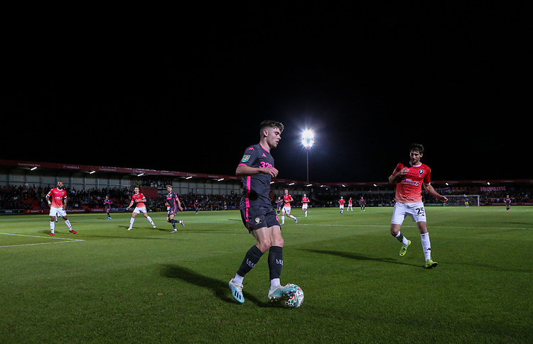 Leeds United's Leif Davis is possession under pressure from Salford City's Joey Jones<br /> <br /> Photographer Alex Dodd/CameraSport<br /> <br /> The Carabao Cup First Round - Salford City v Leeds United - Tuesday 13th August 2019 - Moor Lane - Salford<br />  <br /> World Copyright © 2019 CameraSport. All rights reserved. 43 Linden Ave. Countesthorpe. Leicester. England. LE8 5PG - Tel: +44 (0) 116 277 4147 - admin@camerasport.com - www.camerasport.com