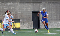 Allston, Massachusetts - May 15, 2014:  In a National Women's Soccer League (NWSL) match, Chicago Red Stars (white/blue) defeated Boston Breakers (blue), 3-1, at Harvard Stadium.