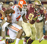 Clemson quarterback Deshaun Watson scrambles past Florida State's Walvenski Aime in the first half of an NCAA college football game in Tallahassee, Fla., Saturday, Oct. 29, 2016. (AP Photo/Mark Wallheiser)