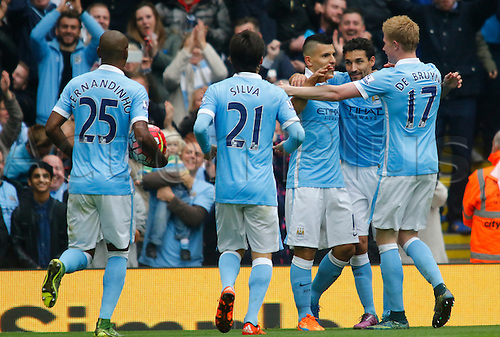 03.10.2015. Manchester, England. Barclays Premier League. Manchester City versus Newcastle United. A fourth goal for Aguero is celebrated by his teammates.